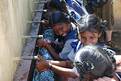 Girls wash up at restored water taps