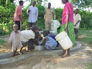 Children play at their new well