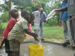 The Water Project : children-tossing-water