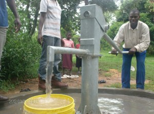 The Water Project : church-member-pumping-water