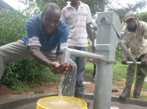 The Water Project : drillers-enjoying-their-work