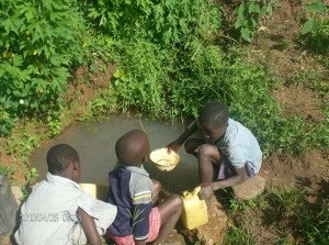 The Water Project : emulundu-kids-fetching-water_web