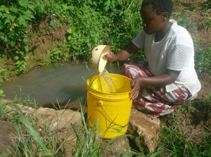 The Water Project : emulundu-mother-hauling-water_web