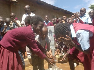 The Water Project : nabongo-primary-pupils-tossing-water_web
