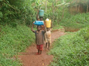 The Water Project : st-james-a-c-k-childrens-walking-5km-away-to-haul-dirty-water_web
