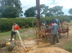 The Water Project : adding-of-drilling-water-to-sunction-pit-_web