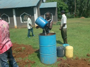 The Water Project : church-members-helping-in-bringing-drilling-water_web