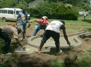 The Water Project : plastering-well-pad-drainage_web