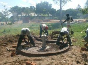 The Water Project : ark-of-orphans-costruction-of-well-drainage-pad