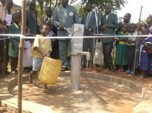 The Water Project : an-orphan-child-of-the-ark-coming-along-with-container-to-collect-during-handover-ceremony