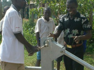 The Water Project : attachment-of-pump-water-tank-at-ark-of-orphans