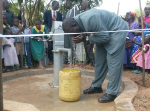 The Water Project : bwp-gm-enjoying-water-at-ark-of-orphans-during-handover-ceremony