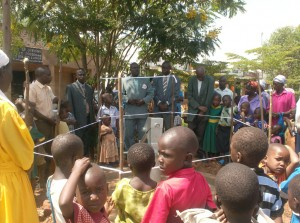 The Water Project : bwp-gm-officilly-handing-over-new-well-to-the-ark-members