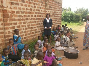 The Water Project : orphans-of-ark-having-their-lunch-with-their-health-officer