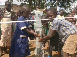 The Water Project : orphans-of-the-ark-enjoying-their-new-well-as-water-flows