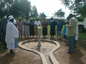 The Water Project : prayer-time-over-the-well-at-ack-enanga-during-handover-ceremony