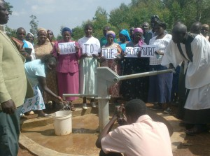 The Water Project : st-james-ack-enanga-church-members-expressing-their-thanks-during-handover-ceremony-2