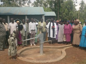 The Water Project : water-flowing-at-st-james-ack-enanga-during-handover-ceremony