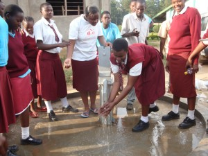 The Water Project : bishop-sulumeti-girls-water-flowing