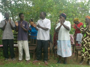 The Water Project : emulundu-community-members-singing-during-hand-over