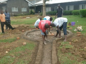 The Water Project : mukumu-girls-school-men-at-work-during-construction-phase