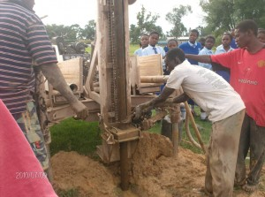 The Water Project : stmarys-girls-high-school-bwp-men-at-work-during-drilling-process