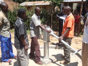 The Water Project : hirumbi-primary-school-fixing-of-pump-handle