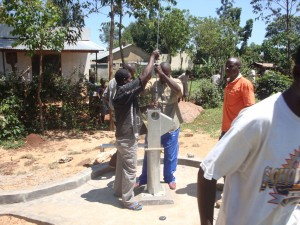 The Water Project : hirumbi-primary-school-installation-of-pump-rods