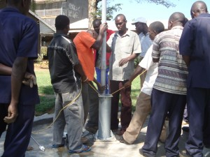 The Water Project : mukumu-sec-school-installation-of-rising-pipes