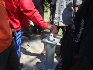 The Water Project : mukumu-school-inserting-of-footvalve