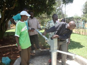 The Water Project : malindi-girls-school-fixing-of-pump-handle