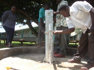 The Water Project : malindi-girls-secschool-water-flowing-after-pump-installation