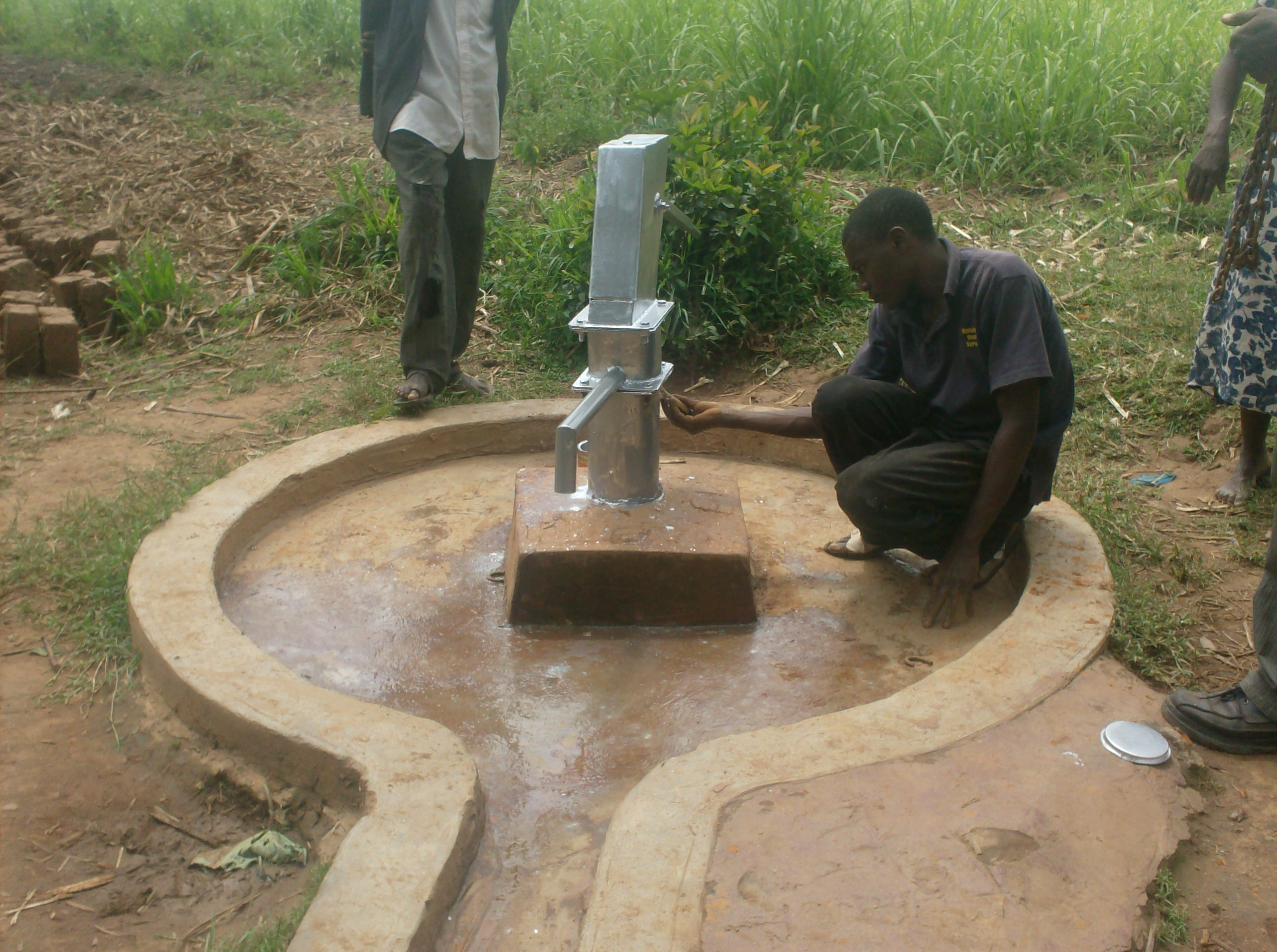 The Water Project : aleko-community-well-painting-of-the-pump-post-during-rehab