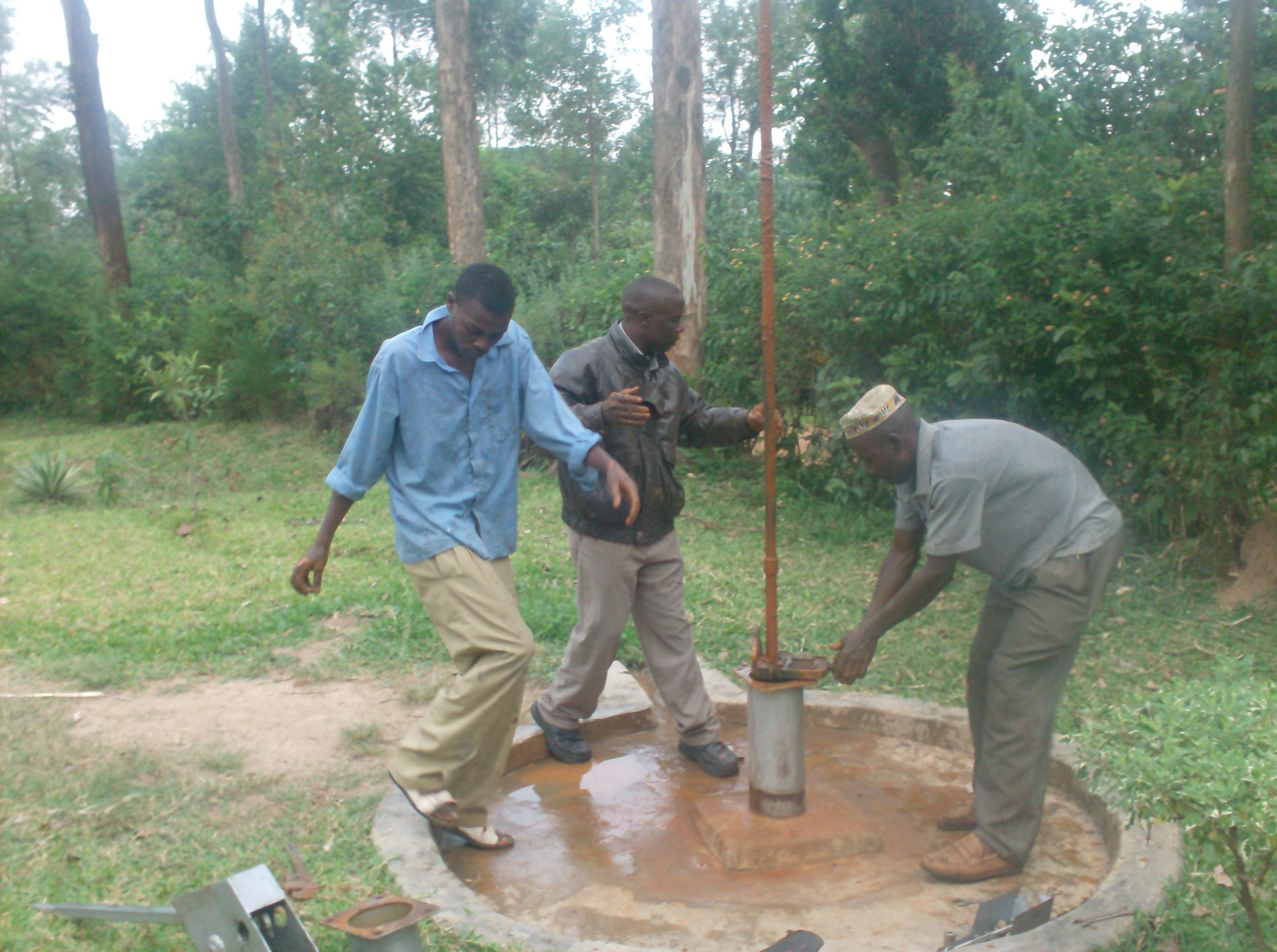 The Water Project : emusungururu-community-well-disconnection-of-gi-pipes-during-rehab