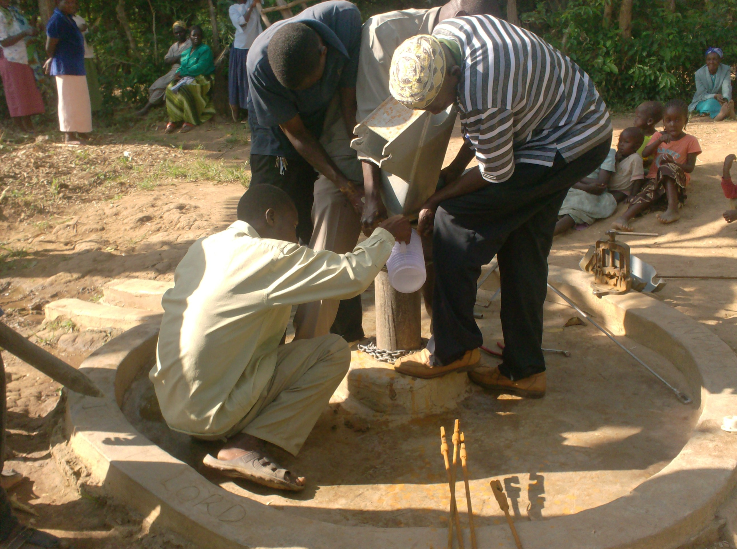 The Water Project : sokone-community-well-chlorination-of-the-well-after-rehab