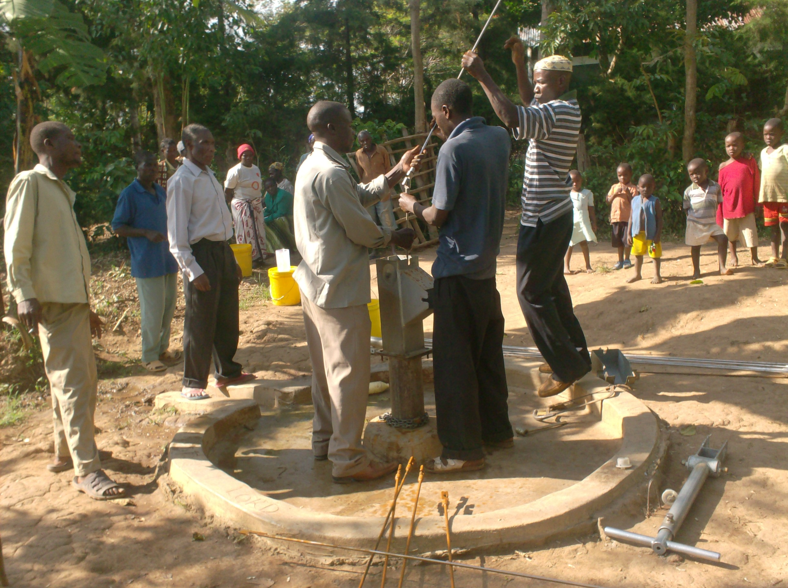 The Water Project : sokone-community-well-replacement-of-the-rods-during-rehab