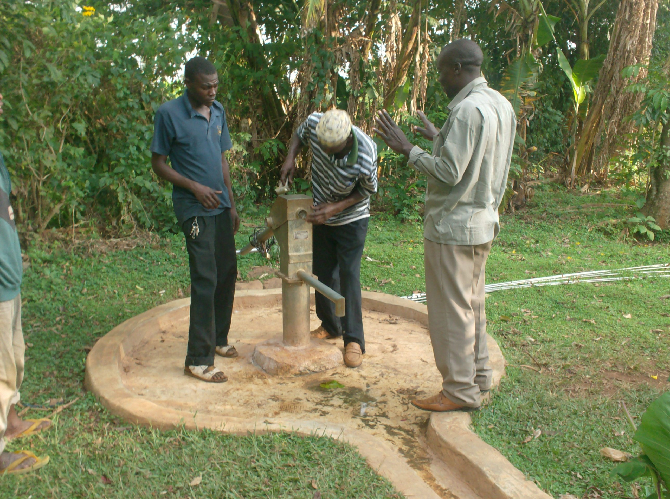 The Water Project : st-thomas-ack-lunza-well-opening-of-pump-head-during-rehab