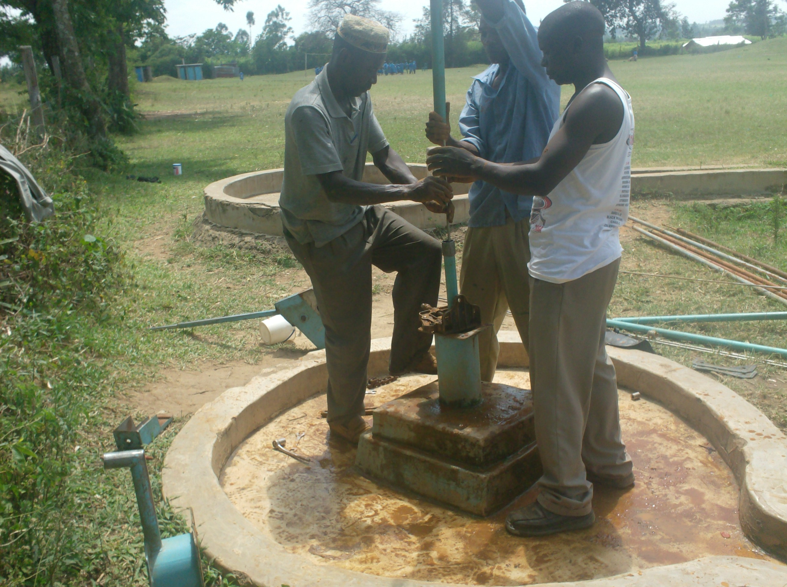The Water Project : vashele-primary-school-connecting-of-pump-rods-during-well-rehab