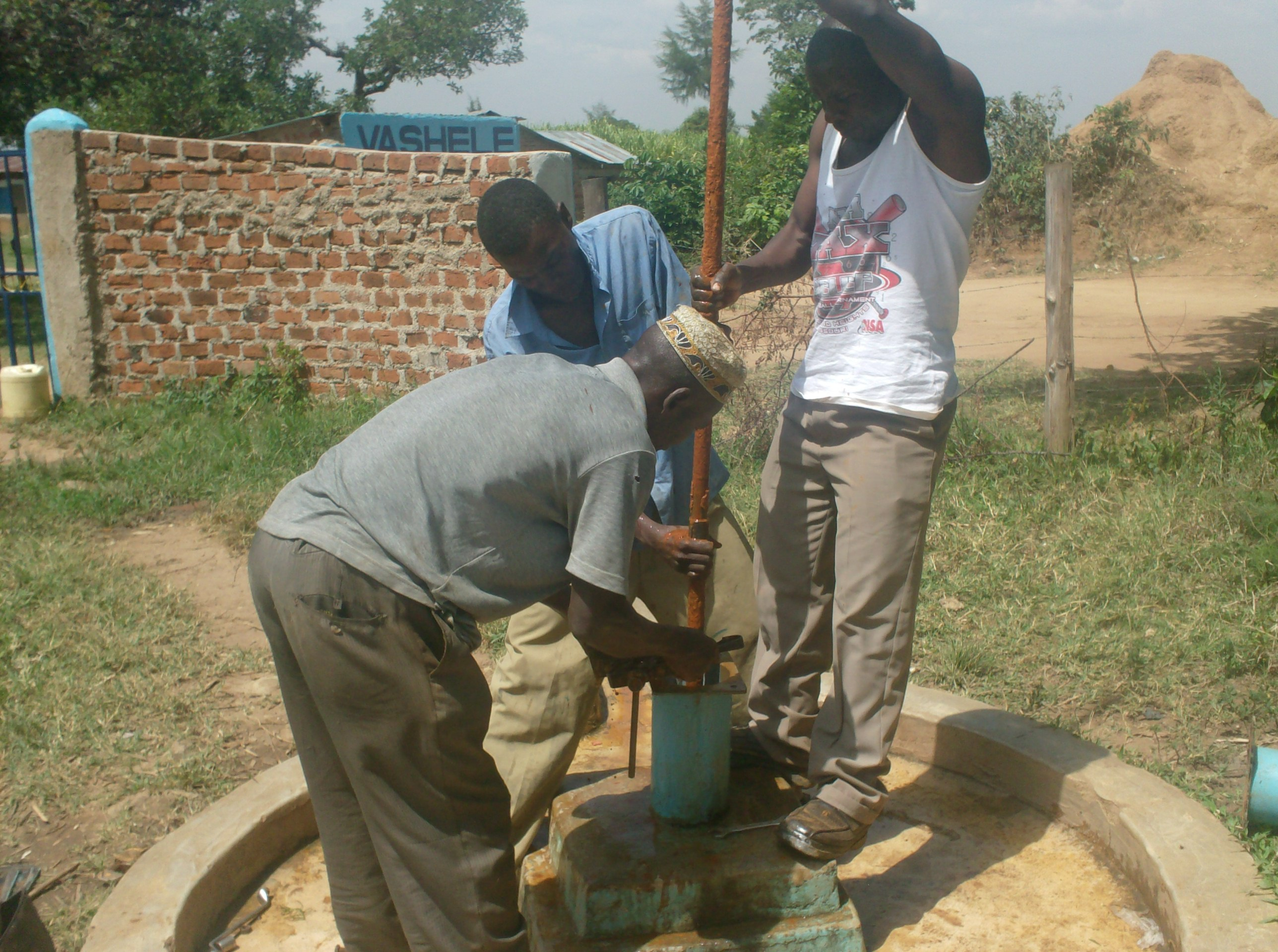 The Water Project : vashele-primary-school-dis-connection-of-gi-pipes-during-well-rehab