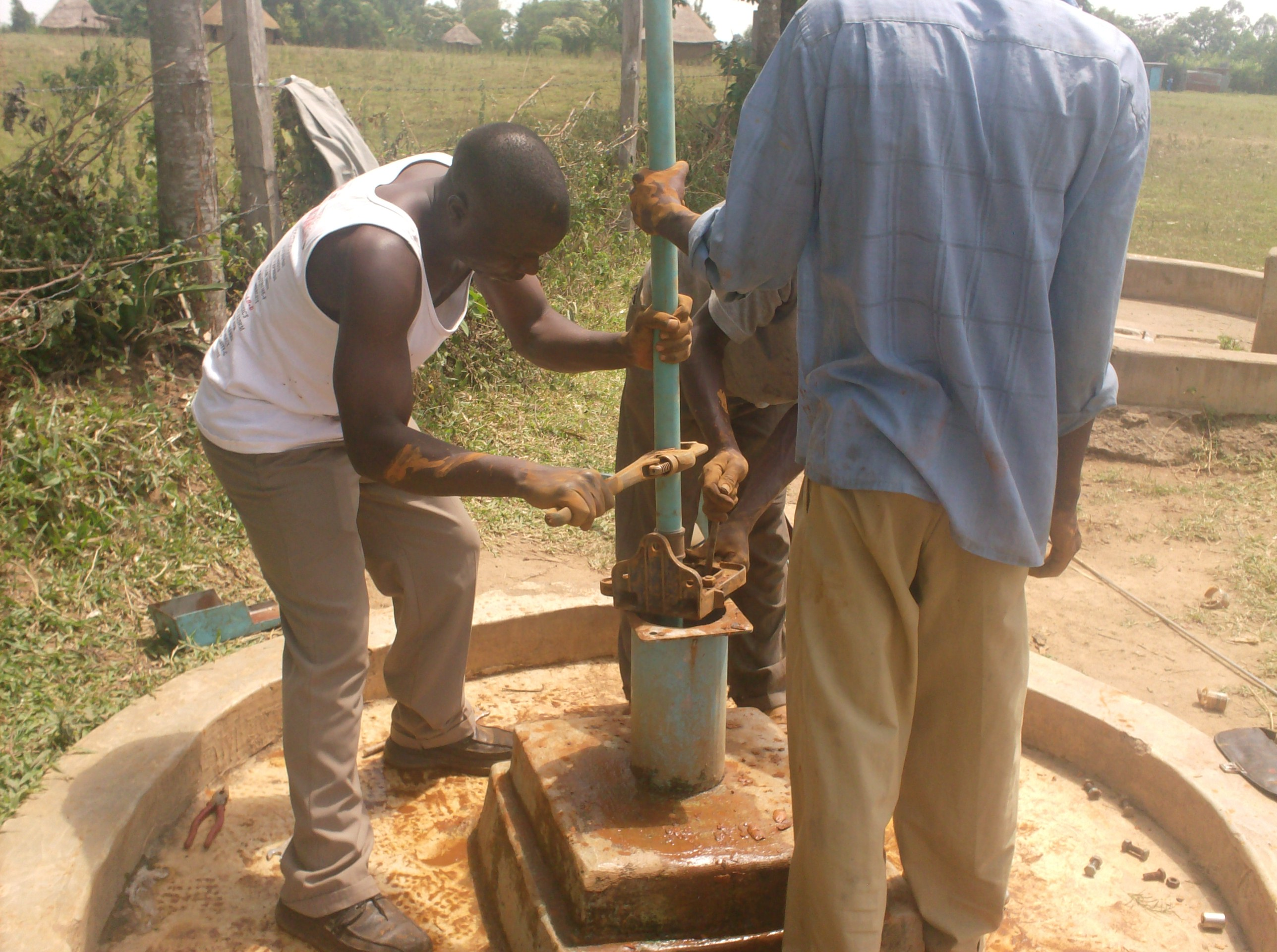 The Water Project : vashele-primary-school-fixing-of-rising-pipes-during-well-rehab