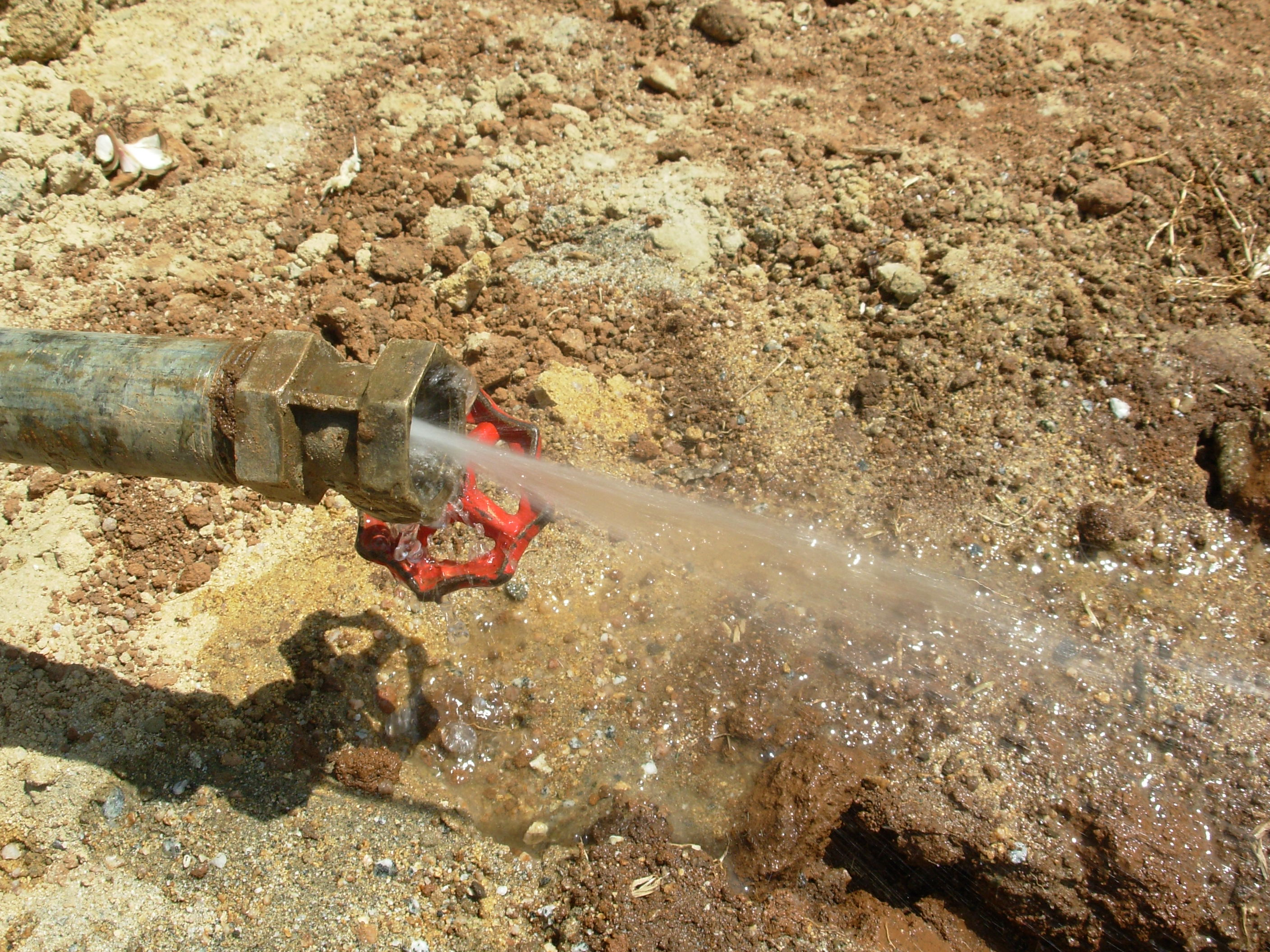 The Water Project : flowing-water-during-test-pumping