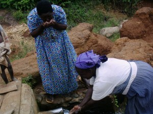 The Water Project : musembe-mbakalo-a-quick-drink-from-the-spring-1280x960