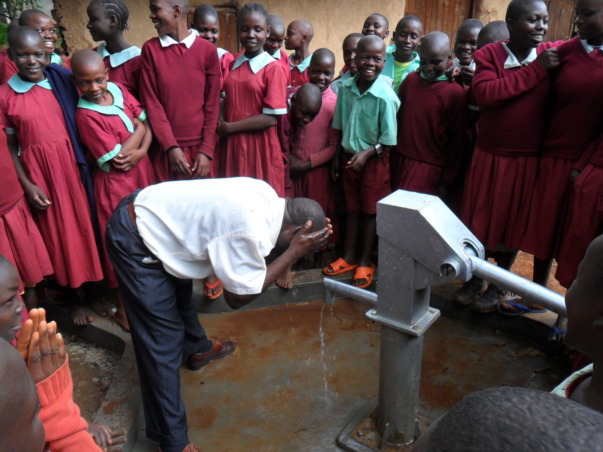 The Water Project : deputy-headteacher-washes-his-face-during-hand-over-of-hirumbi-primary-school-2