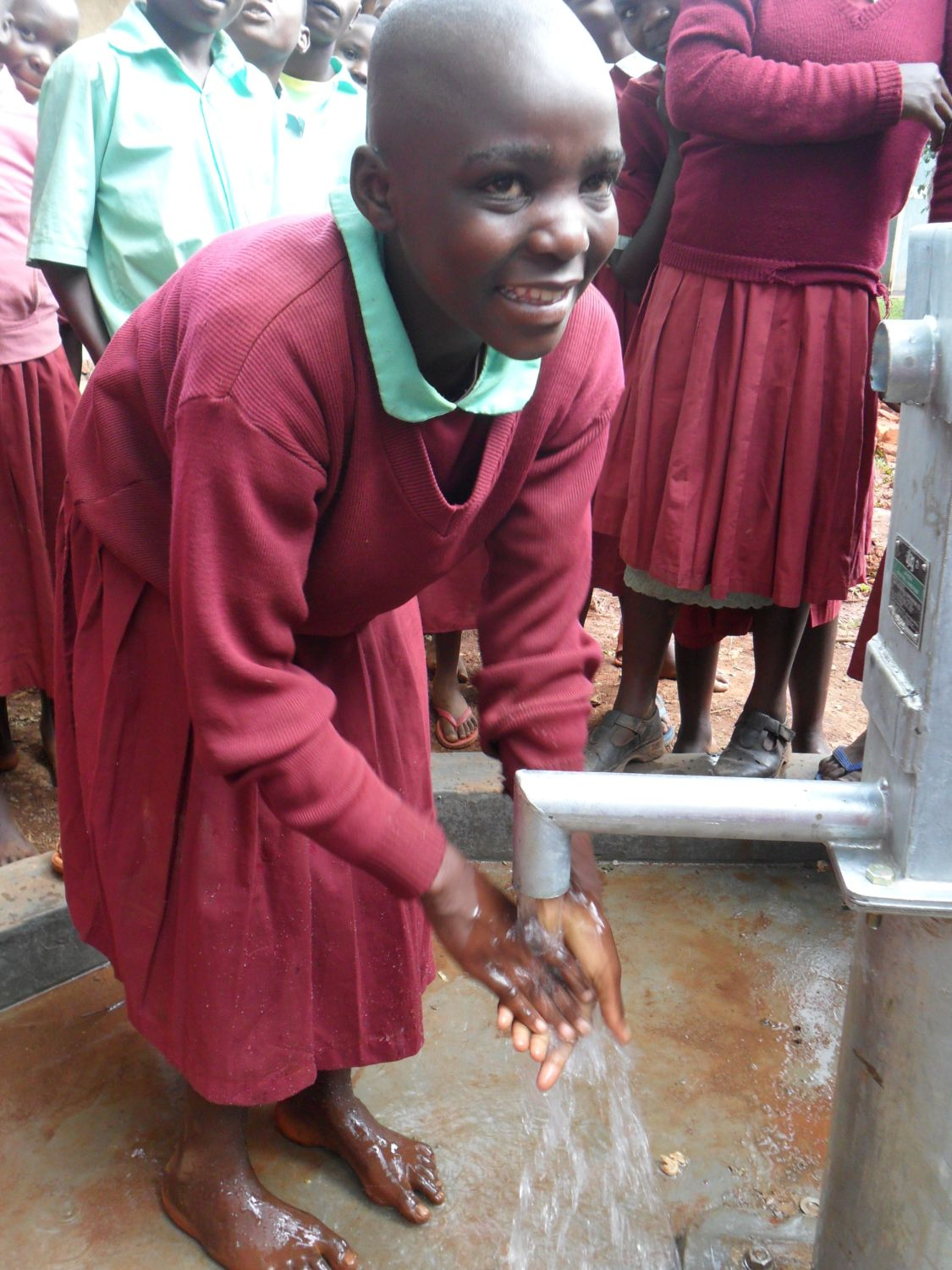 The Water Project : happy-girl-enjoys-water-at-hirumbi-primary-school-2