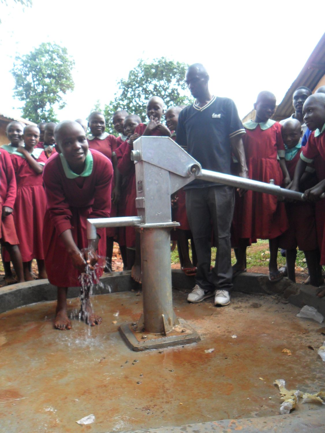 The Water Project : happy-hirumbi-pupils-receive-their-water-system-officially-2