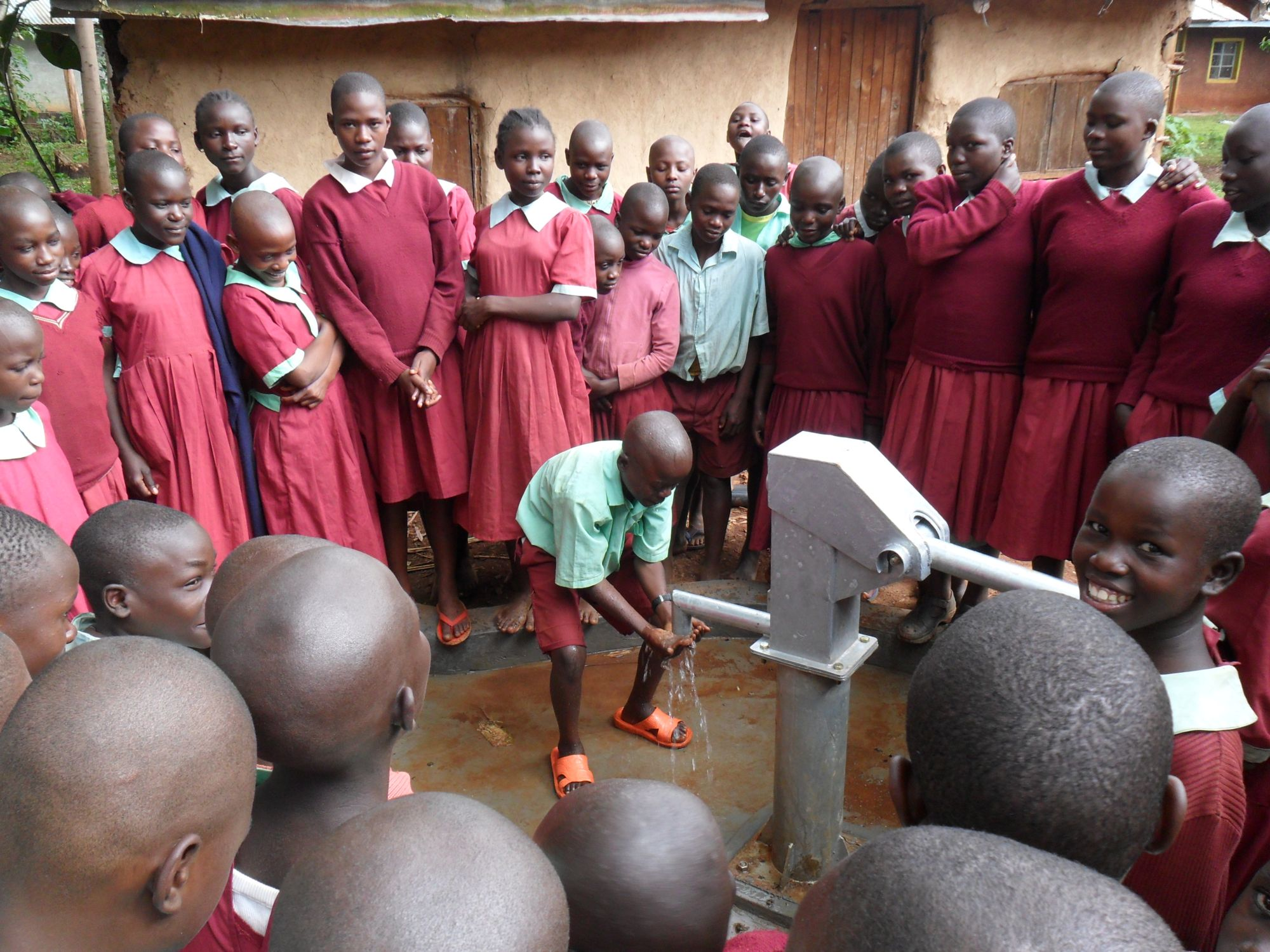 The Water Project : pupils-celebrating-after-handing-over-of-hirumbi-primary-well-2