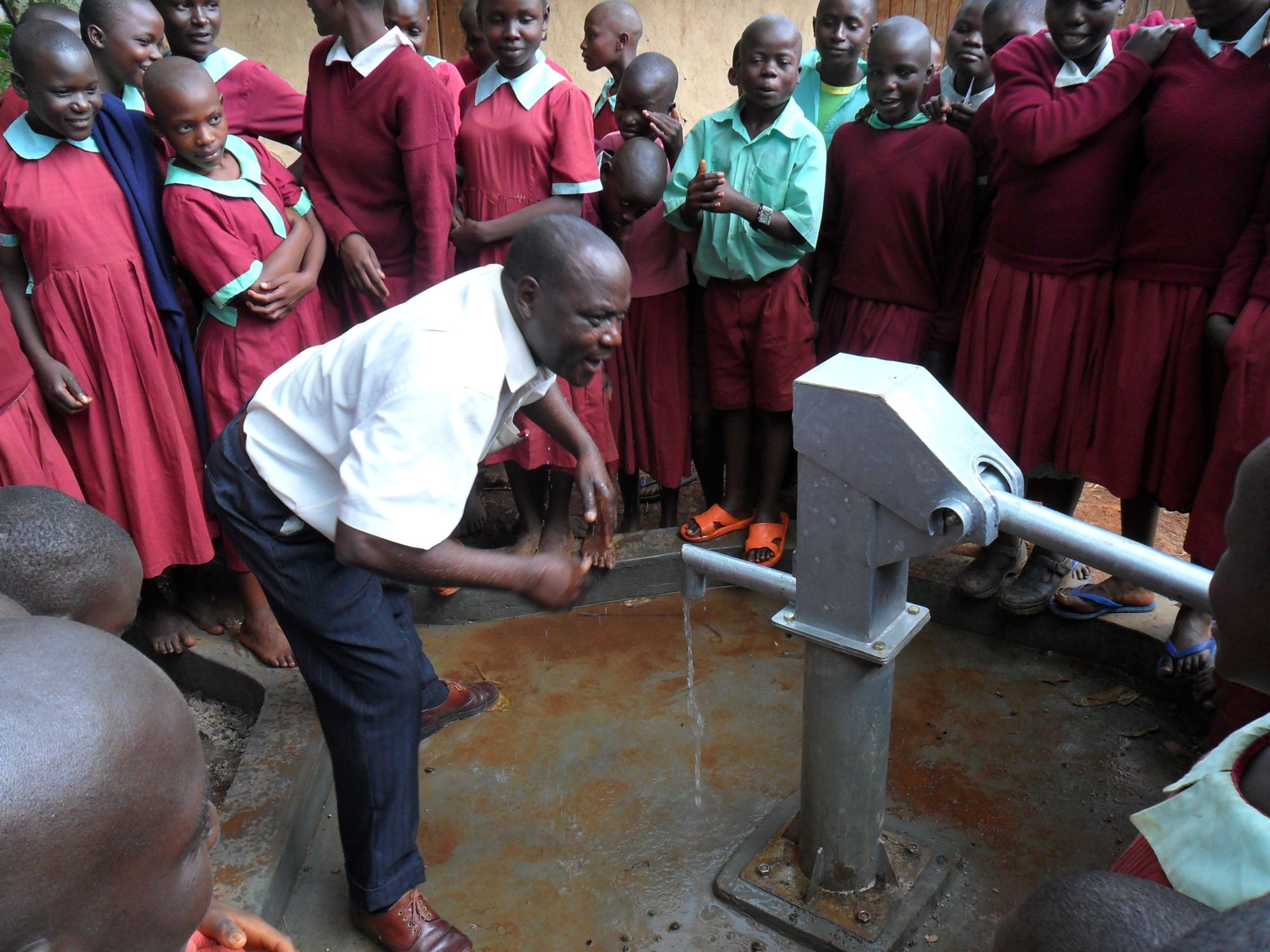The Water Project : the-headteacher-is-happy-during-the-hand-over-at-hirumbi-primary-school-2