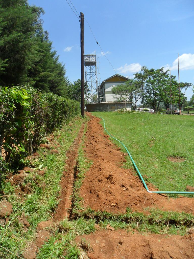 The Water Project : a-trench-dug-for-pipes-during-installation-of-pump-at-manyala-hospital