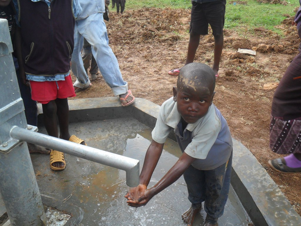 The Water Project : a-happy-child-washing-hands-madioli-primary