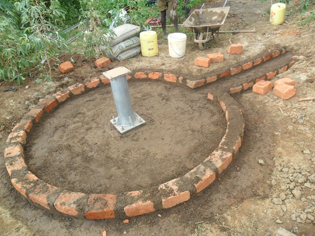 The Water Project : pad-construction-eshiamache-community-3